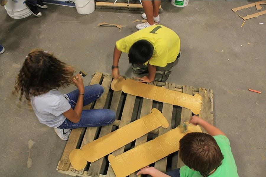 Students continue their hard work on their float