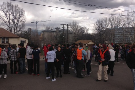 Students wait for the all clear after a fire alarm forces evacuation.