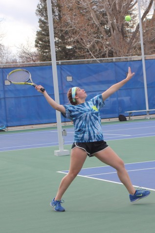 Mason Lores serves during game one of her match.