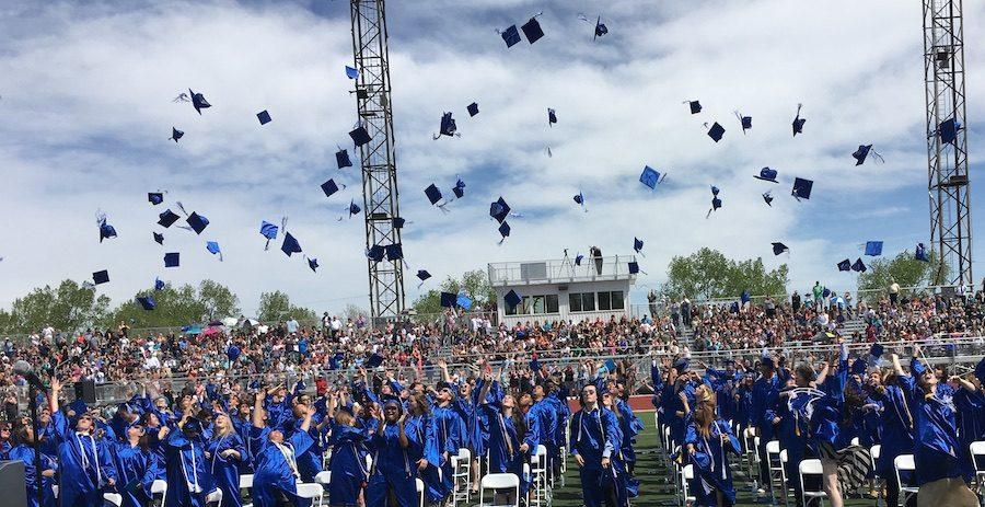 2016 graduates throw their caps in the air to celebrate this milestone