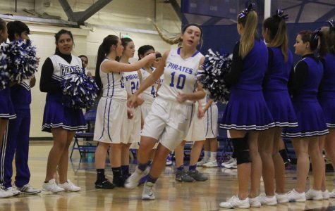 Girls basketball team honors player from another school