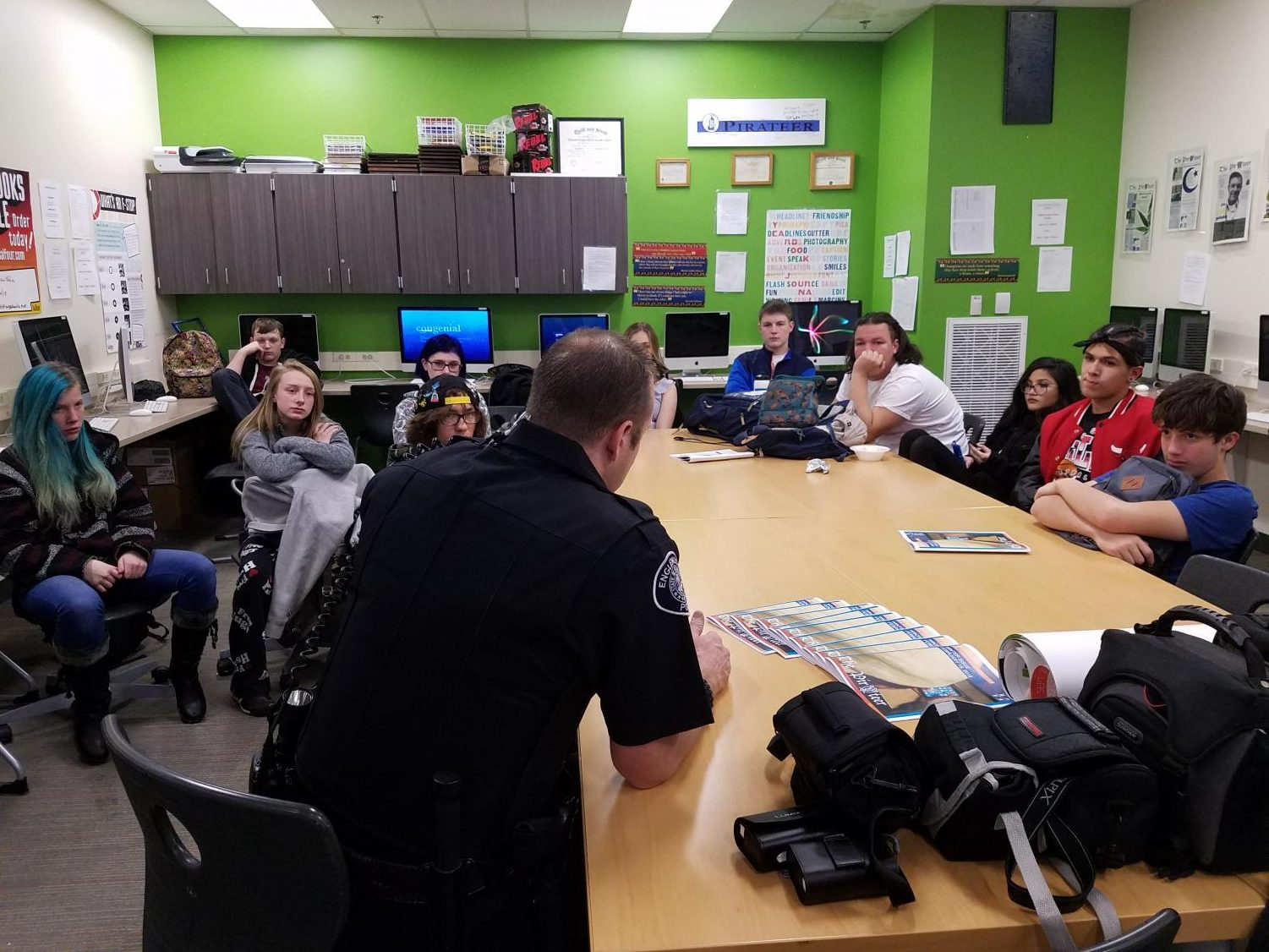 Officer Watts talks to journalism students.
