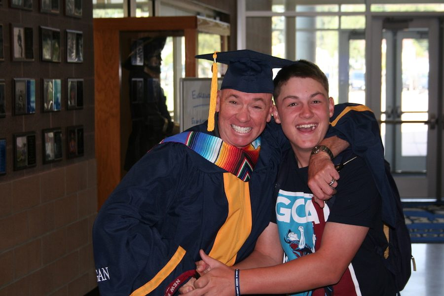Randall Neal is congratulated by student Thomas OConnor after his ceremony.