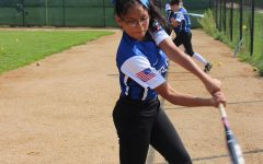 Softball girls fight the good fight in the first home game
