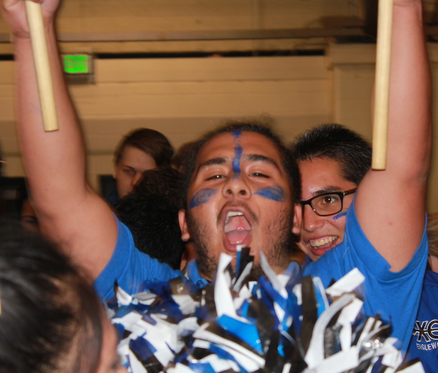 Carlos Martinez (12) waves the class flag and shares his school spirit.