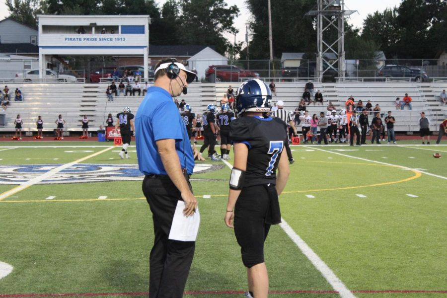 Coach+Campbell+and+quarterback+Mason+Robertson+%2811%29+discuss+a+play+call+on+one+of+the+Pirates+successful+drives+Friday