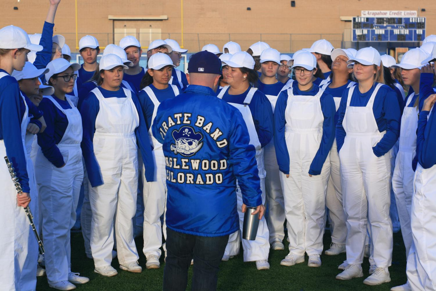 Band Director Phil Emery (in blue jacket) organizes students ahead of the state competition.