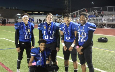 Pirate seniors (l-r #8 Tylor Balderrama, #53 Johnathan Ashlock, #3 Ikaika Gonzalez-Bentosino, #32 Ti'Rick Ivory, #18 Steven Harris) gather together before their final game at Englewood