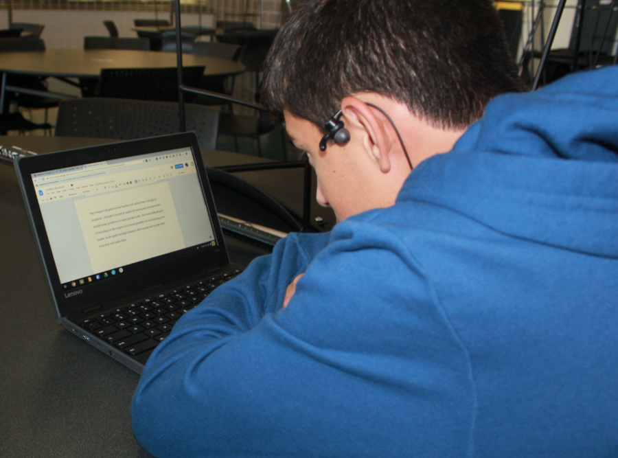 A student uses the Chromebooks to complete classwork.
