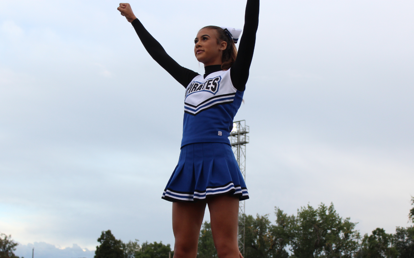 Bria Look (12) stands on top of a pyramid during a recent football game.