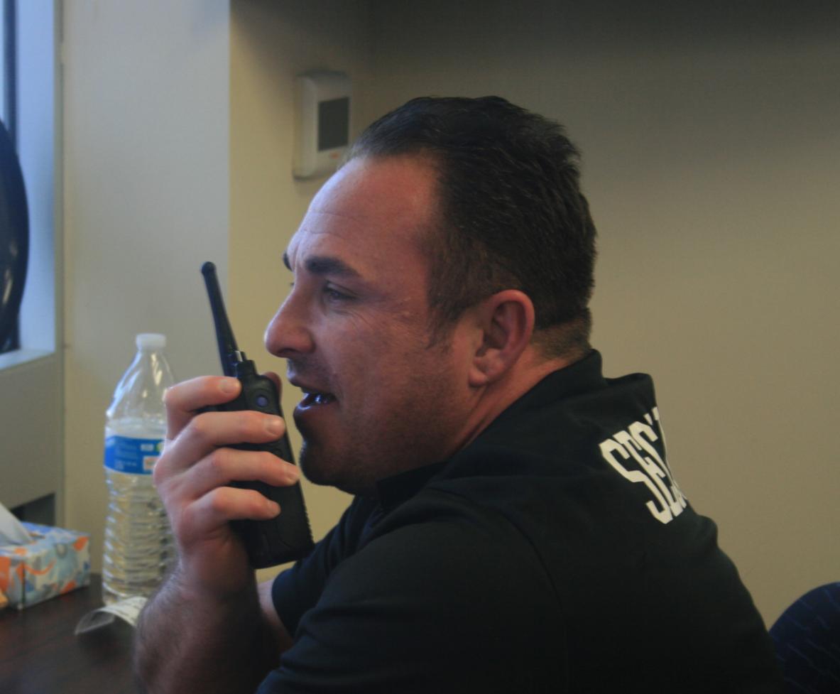 Security Steven Heit handles front desk duty just weeks ahead of spring break.