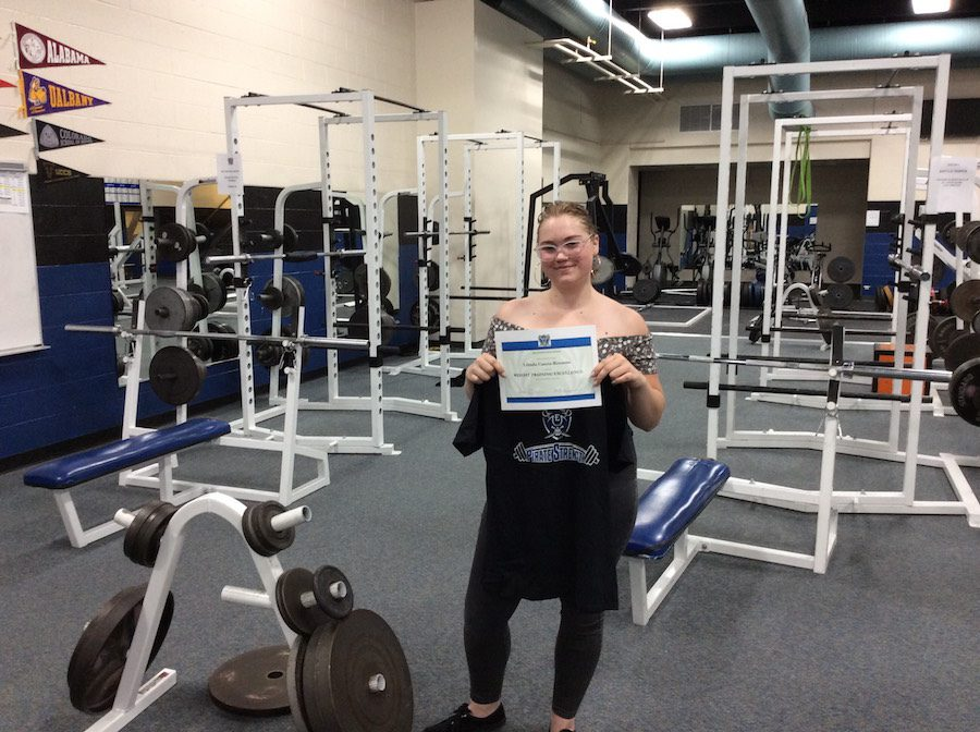 Lihnda Casica-Rotunno set new women records in the weight room.
