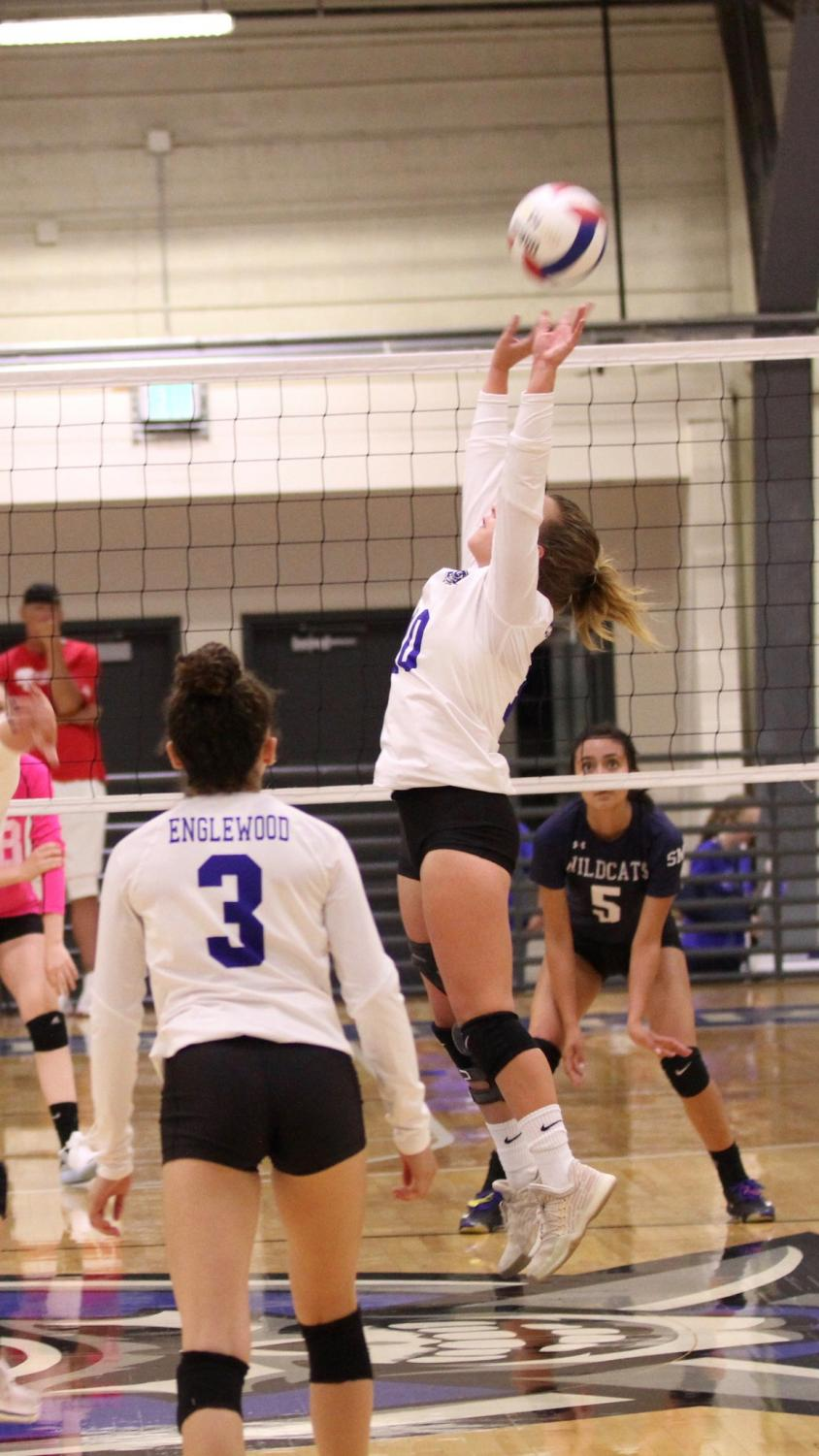 As+a+setter%2C+Hainey+has+a+reach+that+makes+her+taller+than+her+small+stature.+