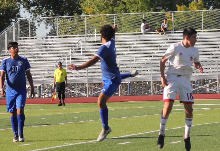 Number 5, Kirollos Naseef,  jumps to meet the ball mid-air