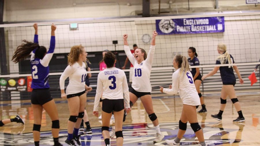 Hainey, number 10, celebrates a great play with her team. This is a strong group, having played together for many years.