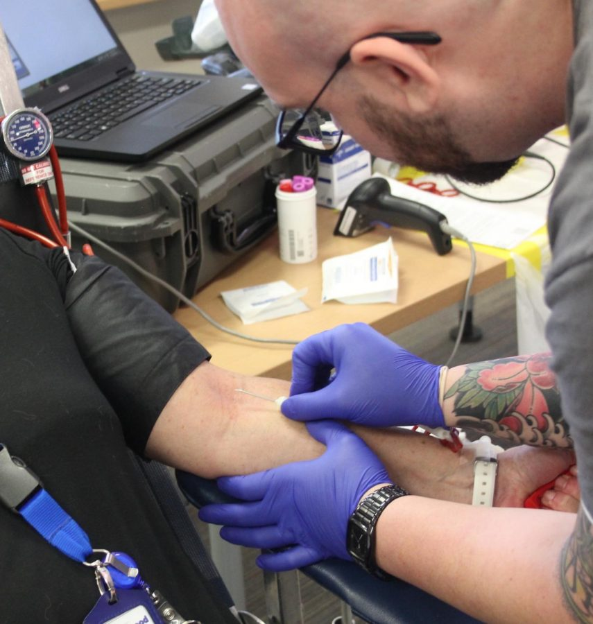 Workers prepare a donor for the blood draw. The procedure usually takes around 20-minutes.