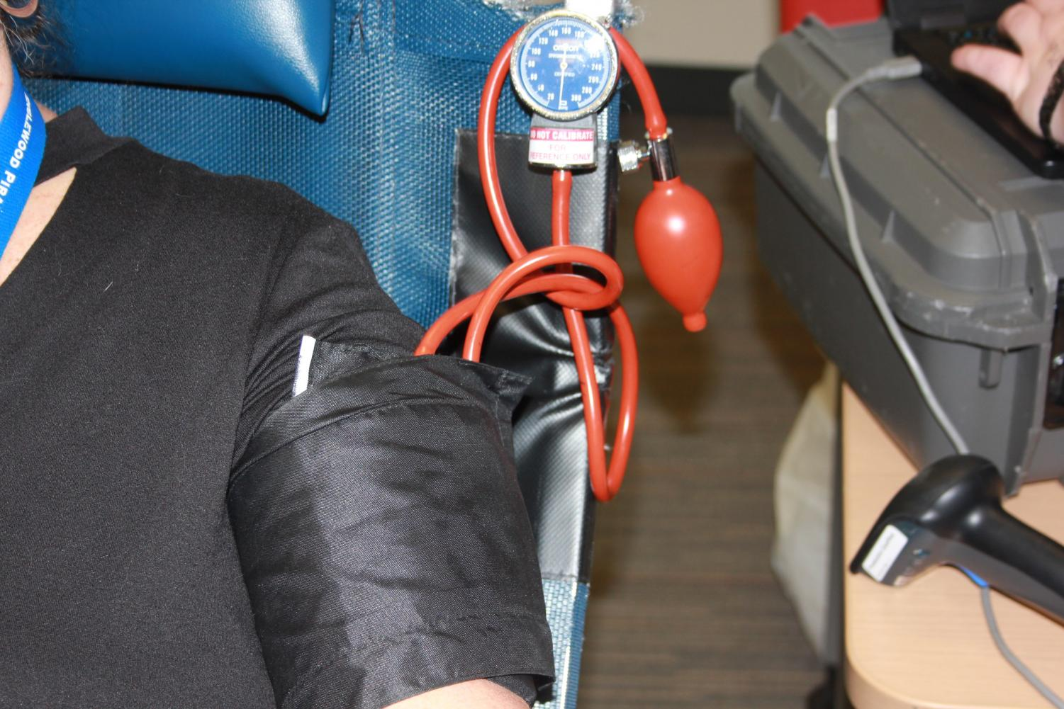 A+student+is+being+monitored+after+donating+blood+during+the+annual+Honor+Society+blood+drive.+
