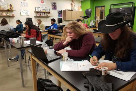 Senior Kayden McCaskey and sophomore Julian Stell work out a problem during bio-med class. They are working with beans to  find prototypes of DNA.