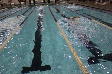 Swimmers take to the water during a meet. Athletes hone their skills by practicing at the Rec center each day during the season.