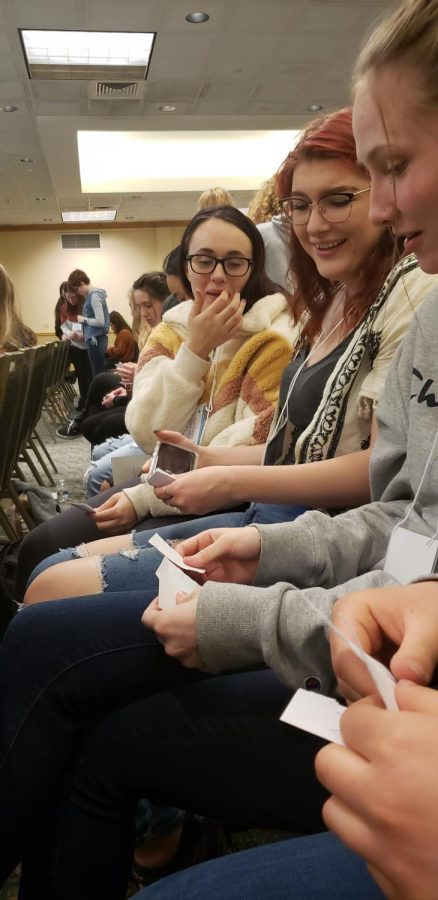Guin Sailors, Jenna Perry, and Shy Clanton contemplate their R-P-S strategies as they prepare to take on students from other schools at the Game Theory workshop.