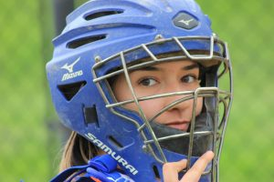 EHS softball catcher sites ready for the first pitch of a recent game.