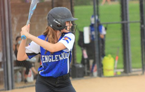 At bat, an Englewood player steadies herself for the first pitch.