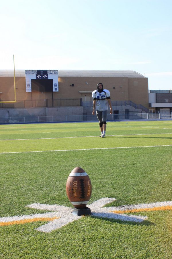 Chris Apodaca practices kicking the football. Apodaca averages 23 yard field goal with the longest kick being 43 yards.