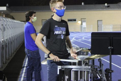 Sophomore Elliot Maschka drums up the crowd during the first home football game of the 2020 season against La Junta.