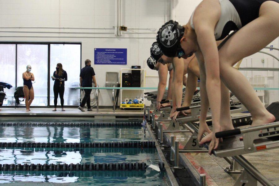 Swim team dives into league meet